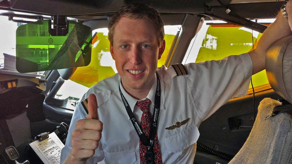 Pilot Rove shows thumbs up from the cockpit