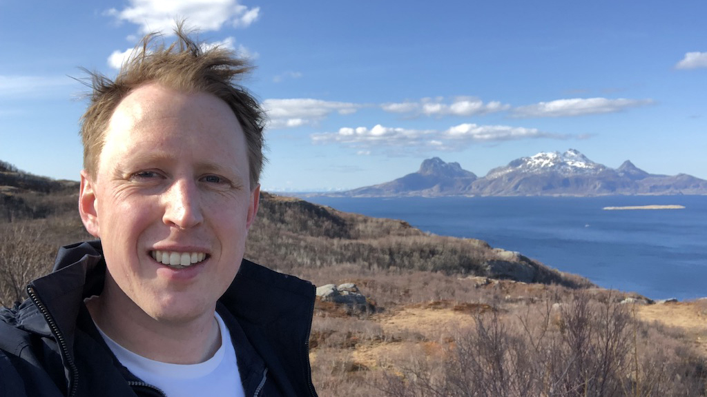 Pilot Rove taking a hike in Molde, mountains and the oceans in the distance